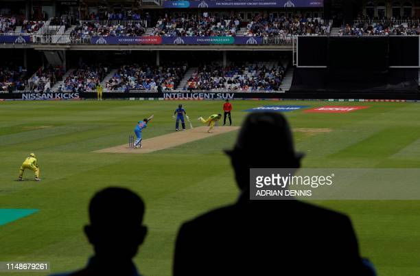 India's captain Virat Kohli plays a shot back towards Australia's Nathan Coulter-Nile during the 2019 Cricket World Cup group stage match between...