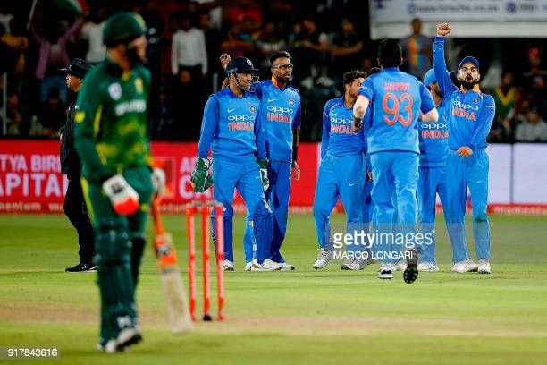India's captain Virat Kohli reacts after India's bowler Kuldeep Yadav bowled out South Africa's batsman Andile Phehlukwayo during the fifth one day...