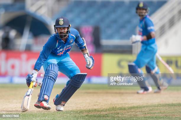 India's Captain Virat Kohli scores a run during the fifth One Day International match between West Indies and India at the Sabina Park Cricket Ground...