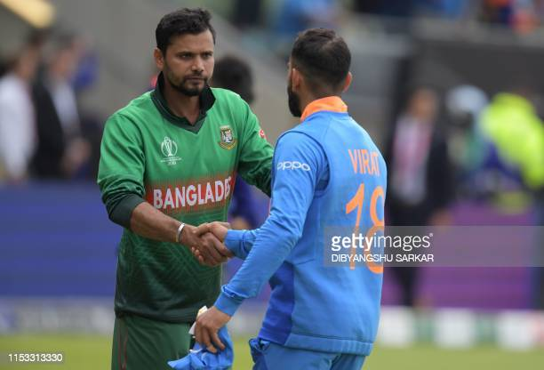 India's captain Virat Kohli shakes hands with Bangladesh's captain Mashrafe Mortaza as he celebrates after victory in the 2019 Cricket World Cup...