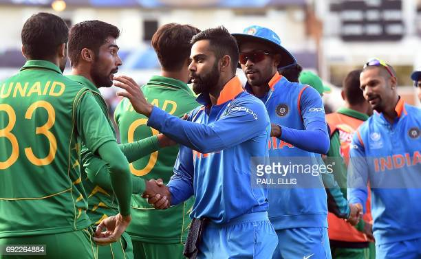 India's captain Virat Kohli shakes hands with Pakistan players after the ICC Champions trophy match between India and Pakistan at Edgbaston in...