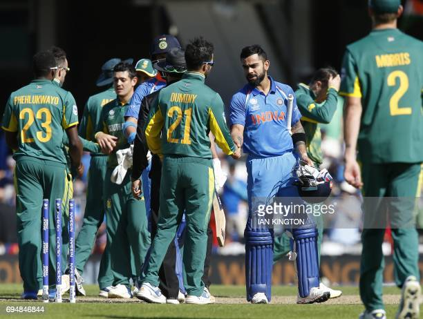 India's captain Virat Kohli shakes hands with South Africa's JP Duminy after the ICC Champions Trophy match between South Africa and India at The...