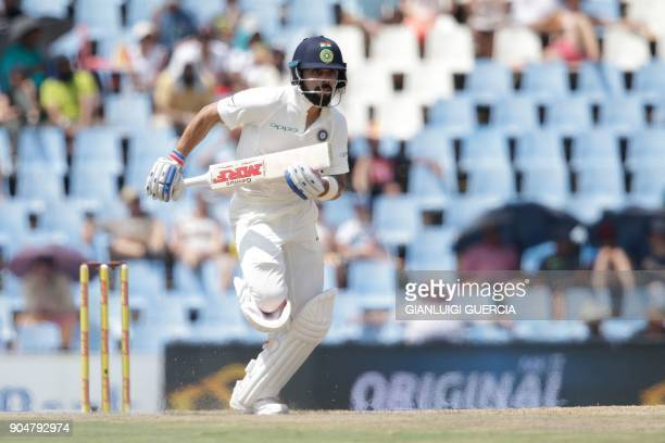 India's captain Virat Kohli takes a run during the second day of the second Test cricket match between South Africa and India at Supersport cricket...