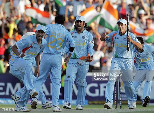 India's caption Mahendra Singh Dhoni and his team celebrate India's beating Pakistan the Twenty20 cricket world championship final at Wanderer's...