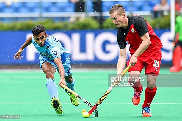 India's Chandanda Thimmaiah and Poland's Mateusz Poltaszewski vie for the ball during the Group A men's group stage match between India and Poland at...