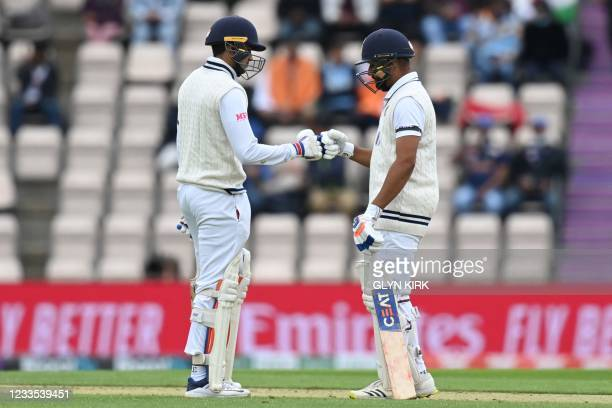 India's Cheteshwar Pujara and India's Shubman Gill touch gloves on the second day of the ICC World Test Championship Final between New Zealand and...
