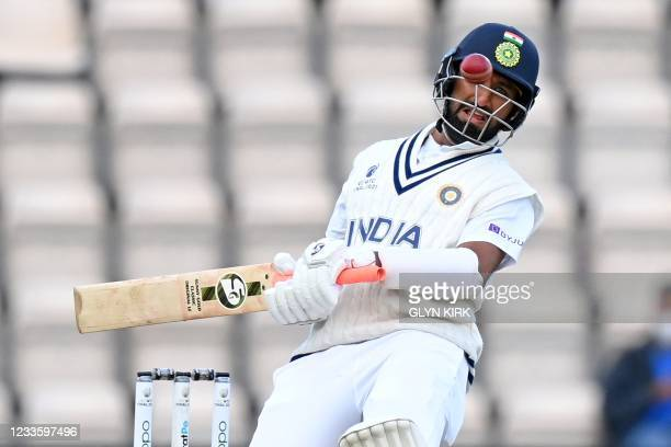 India's Cheteshwar Pujara avoids a bouncing ball bowled by New Zealand's Kyle Jamieson on the fifth day of the ICC World Test Championship Final...