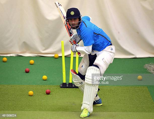India's Cheteshwar Pujara bats in the indoor nets during a rain affected second day of the cricket Tour Match between Leicestershire and India at...