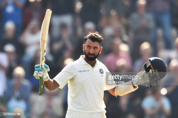 India's Cheteshwar Pujara celebrates his century during the second day of the fourth Test cricket match between England and India at the Ageas Bowl...