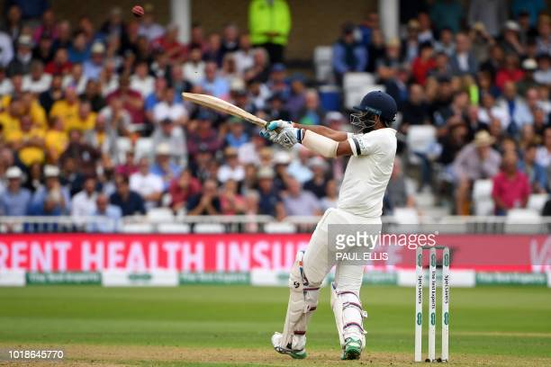 India's Cheteshwar Pujara is caught by England's Adil Rashid playing this shot off the bowling of England's Chris Woakes during play on the first day...