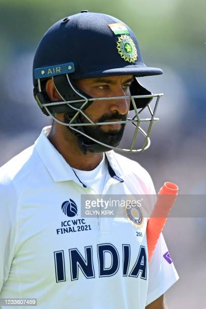 India's Cheteshwar Pujara walks back to the pavilion after losing his wicket for 15 runs on the final day of the ICC World Test Championship Final...