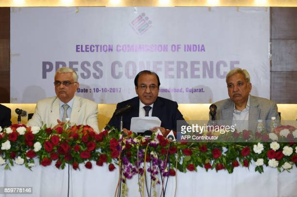 India's Chief Election Commissioner AK Joti speaks next to Election Commissioners OP Rawat and Sunil Arora during a press conference at the Circuit...