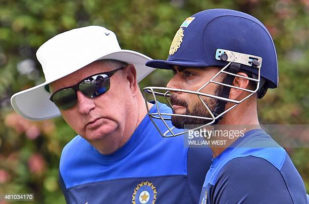 India's coach Duncan Fletcher chats with captain Virat Kohli during cricket training at the Sydney Cricket Ground on January 5, 2015. Australia are...
