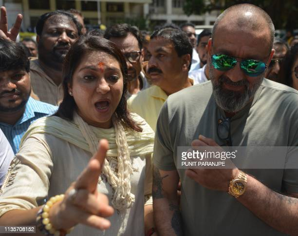 India's Congress Party candidate Priya Dutt and her Bollywood actor brother Sanjay Dutt speaks with the media after Priya filed her nomination in...