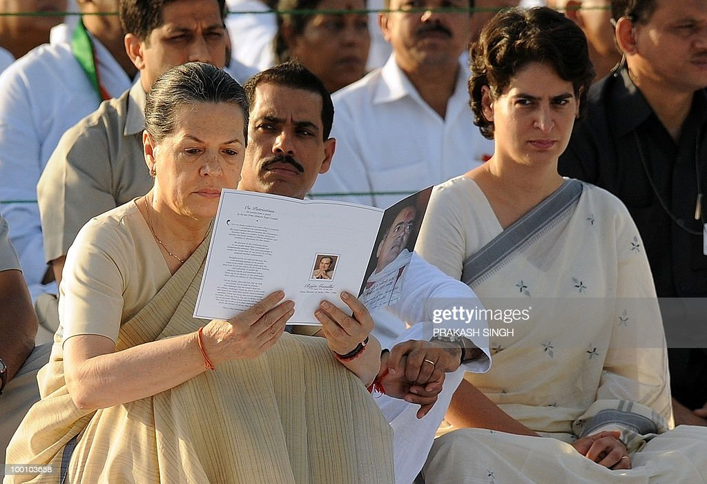 India's Congress Party President Sonia Gandhi (L), her daughter Priyanka Gandhi (R) and Priyanka's husband, Robert Vadra (C) attend a memorial ceremony for slain former Indian prime minister Rajiv Gandhi on his 19th death anniversary in New Delhi on May 21, 2010. Rajiv Gandhi was assasinated during electoral campaigning, allegedly by Liberation Tigers of Tamil Eelam (LTTE) rebel separatists, in the town of Sriperumpudur in the southern state of Tamil Nadu on May 21, 1991. AFP PHOTO/ Prakash SINGH