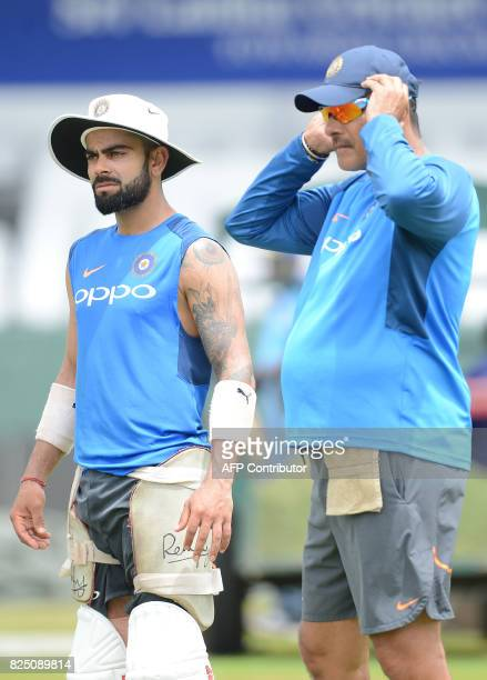 India's cricket captain Virat Kohli and coach Ravi Shastri watch other players at a practice session at the Sinhalease Sports Club Ground in Colombo...