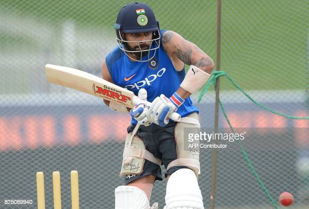 India's cricket captain Virat Kohli hits a ball at a practice session at the Sinhalease Sports Club Ground in Colombo on August 1 2017 The second...