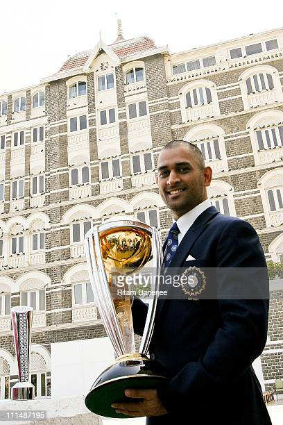 India's cricket team captain Mahendra Singh Dhoni poses with the ICC Cricket World Cup Trophy during a photo call at the Taj Palace Hotel on April 3...