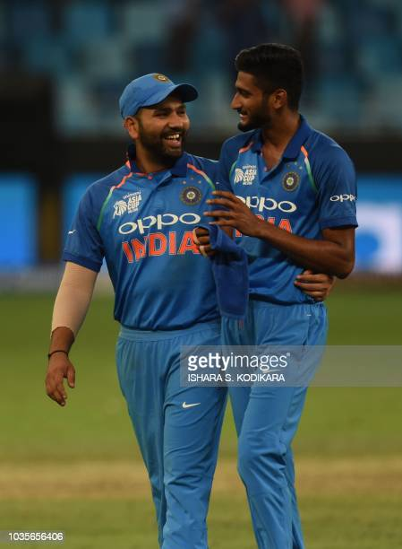India's cricketer Khaleel Ahmed and team captain Rohit Sharma leave the ground after their win over Hong Kong in their one day international Asia Cup...