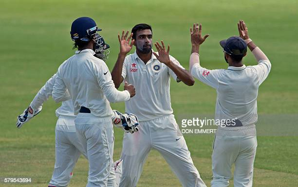 India's cricketer Ravichandran Ashwin celebrates during day four of the cricket test match between West Indies and India July 24 2016 at Sir Vivian...