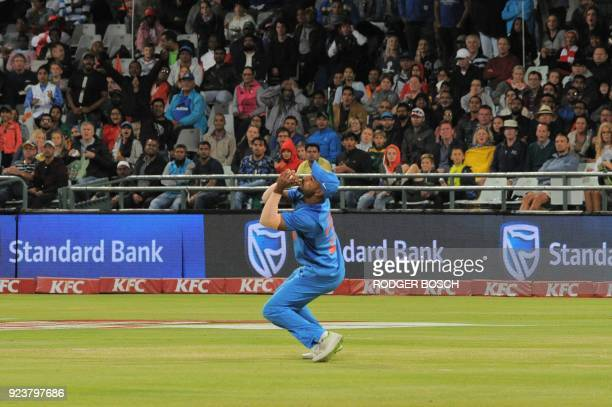 India's cricketer Shikar Dhawan takes the catch to dismiss South Africa's batsman Riaaz Hendricks during the third T20 cricket match between India...