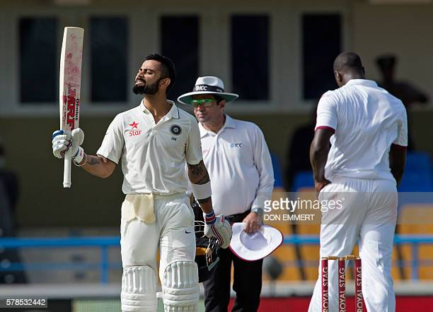 India's cricketer Virat Kohli celebrates 100 runs during day one of the cricket Test match between West Indies and India July 21 2016 at Sir Vivian...