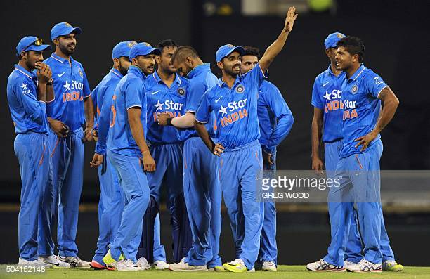 India's cricketers gather during the oneday cricket match between India and a Western Australian XI in Perth on January 9 2016 AFP PHOTO / Greg WOOD...