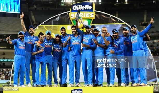 India's cricketers pose with their oneday international series trophy after defeating Australia at the Melbourne Cricket Ground in Melbourne on...