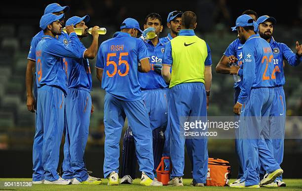 India's cricketers take a drinks break during the oneday cricket match between India and a Western Australian XI in Perth on January 9 2016 AFP PHOTO...