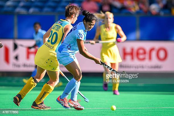 India's Deepika Deepika controls the ball during the semifinal match between Australia and India in Group B of the women's group stage at the World...