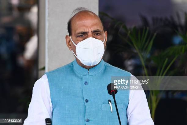 India's Defence Minister Rajnath Singh speaks during a joint press conference with his French counterpart after attending an induction ceremony of...