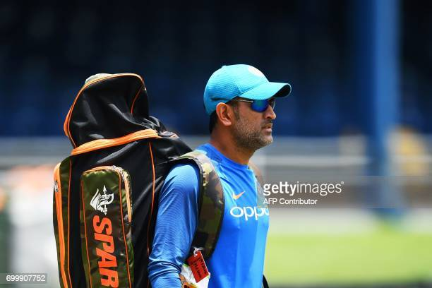 India's MS Dhoni arrives on the field for a practice session at the Queen's Park Oval in Port of Spain Trinidad on June 22 ahead of the first One Day...