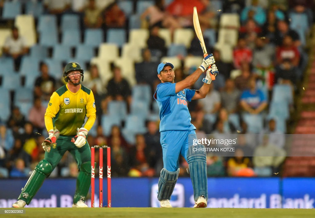 India's MS Dhoni bats during the second T20I cricket match between South Africa and India at Super Sport Park Stadium in Pretoria on February 21, 2018. / AFP PHOTO / Christiaan Kotze