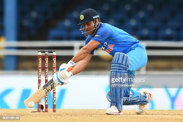 India's MS Dhoni plays a shot during the first One Day International match between West Indies and India at the Queen's Park Oval in Port of Spain...