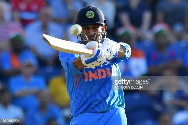 India's MS Dhoni plays a shot during the international Twenty20 cricket match between England and India at Sophia Gardens in Cardiff south Wales on...