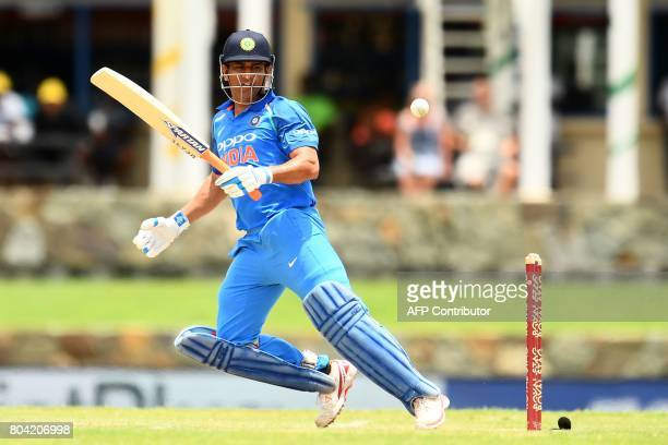 India's MS Dhoni plays a shot during the third One Day International match between West Indies and India at the Sir Vivian Richards Cricket Ground in...