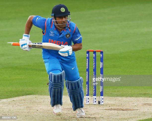 India's MS Dhoni runs between wickets during the ICC Champions Trophy Warmup match between India and New Zealand at The Oval in London on May 28 2017...