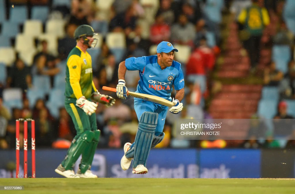 India's MS Dhoni runs during the second T20I cricket match between South Africa and India at Super Sport Park Stadium in Pretoria on February 21, 2018. / AFP PHOTO / Christiaan Kotze