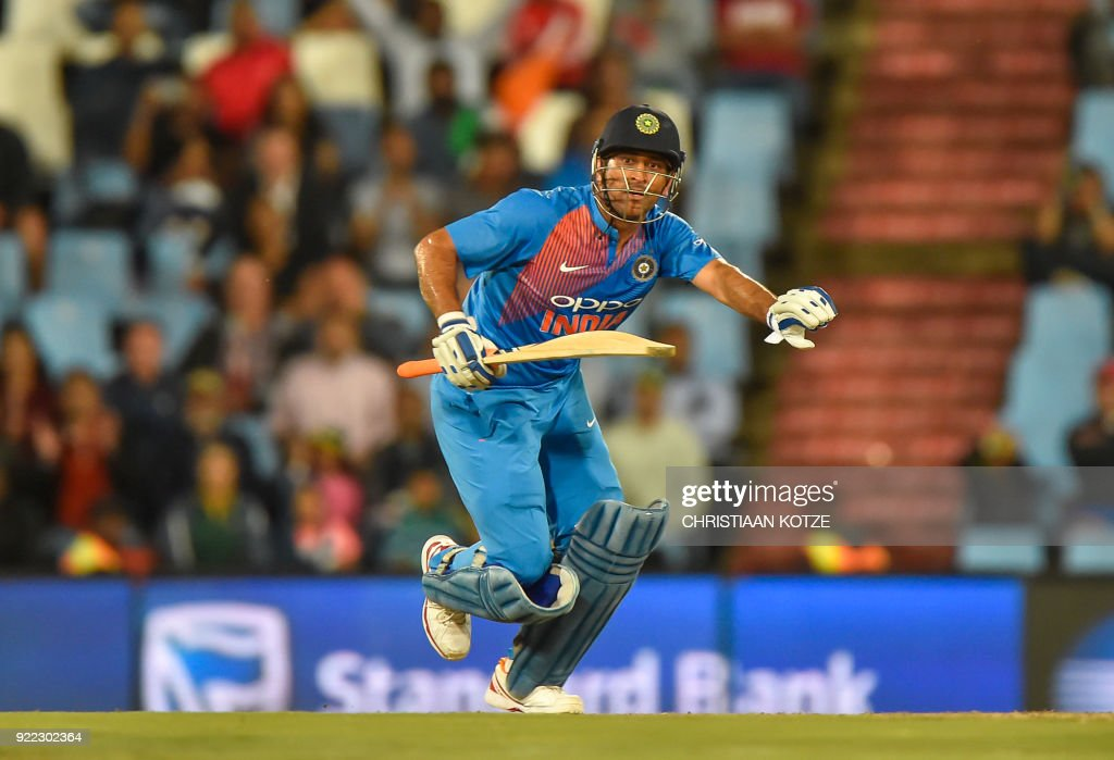 India's Dhoni runs during the second T20I cricket match between South Africa and India at Super Sport Park Stadium in Pretoria on February 21, 2018. / AFP PHOTO / Christiaan Kotze