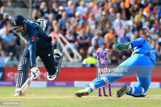 India's MS Dhoni takes the wicket of England's James Vince for 27 runs during the third One Day International cricket match between England and India...