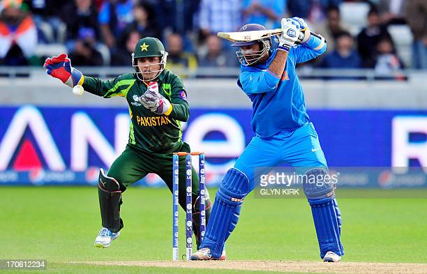 India's Dinesh Karthik bats during the 2013 ICC Champions Trophy cricket match between Pakistan and India at Edgbaston in Birmingham central England...