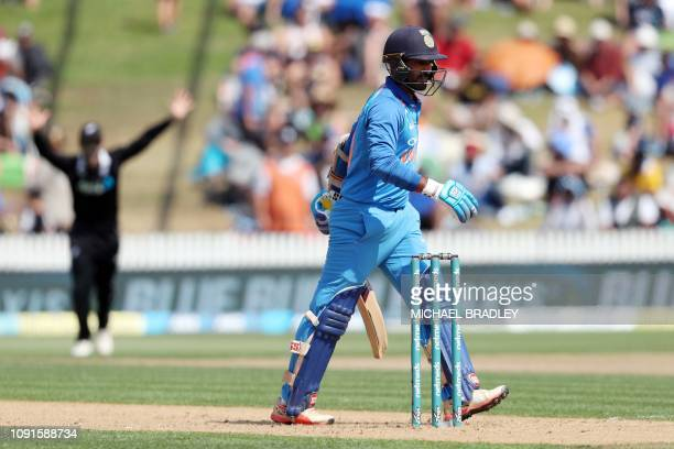 India's Dinesh Karthik is dismissed during the fourth oneday international cricket match between New Zealand and India at Seddon Park in Hamilton on...