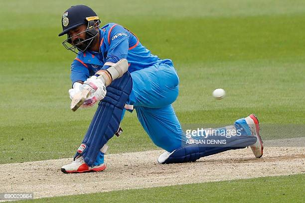 India's Dinesh Karthik plays a shot during the ICC Champions Trophy Warmup cricket match between India and Bangladesh at The Oval in London on May 30...