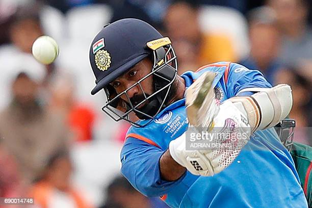 India's Dinesh Karthik plays shot for four runs during the ICC Champions Trophy Warmup cricket match between India and Bangladesh at The Oval in...