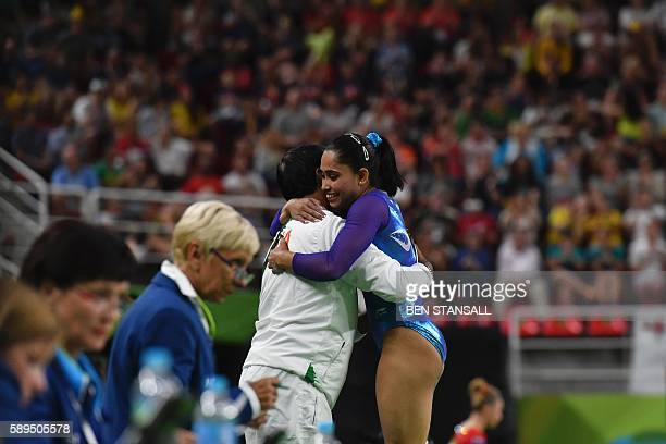India's Dipa Karmakar embraces her coach after competing in the women's vault event final of the Artistic Gymnastics at the Olympic Arena during the...