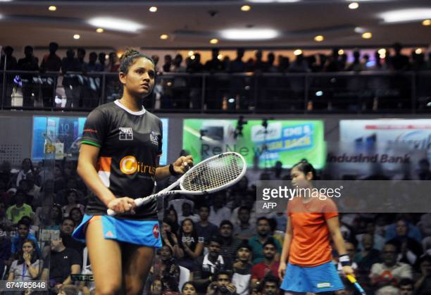 India's Dipika Pallikal celebrates after winning the match against Hong Kong's Annie Au in their women's semifinal match at the 19th Asian Squash...