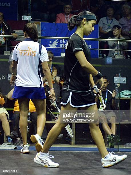 India's Dipika Pallikal leaves the court after losing to Malaysia's Nicol Ann David during the women's squash semifinal match of the 2014 Asian Games...