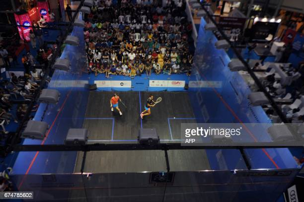 India's Dipika Pallikal plays a shot to Hong Kong's Annie Au during their women's semifinal match at the 19th Asian Squash Championship in Chennai on...