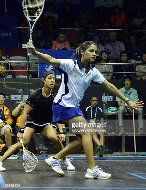 India's Dipika Pallikal returns a shot against Malaysia's Nicol Ann David during the women's squash semifinal match of the 2014 Asian Games at the...