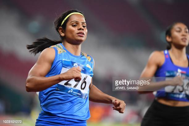 India's Dutee Chand competes in a heat of the women's 100m athletics event during the 2018 Asian Games in Jakarta on August 25 2018